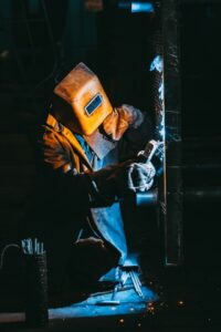 Steel worker wearing protective face shield