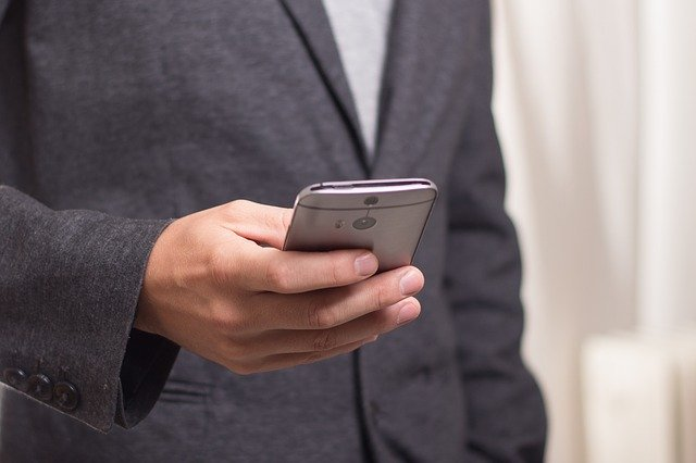 Businessperson Doing Something on a Mobile Phone