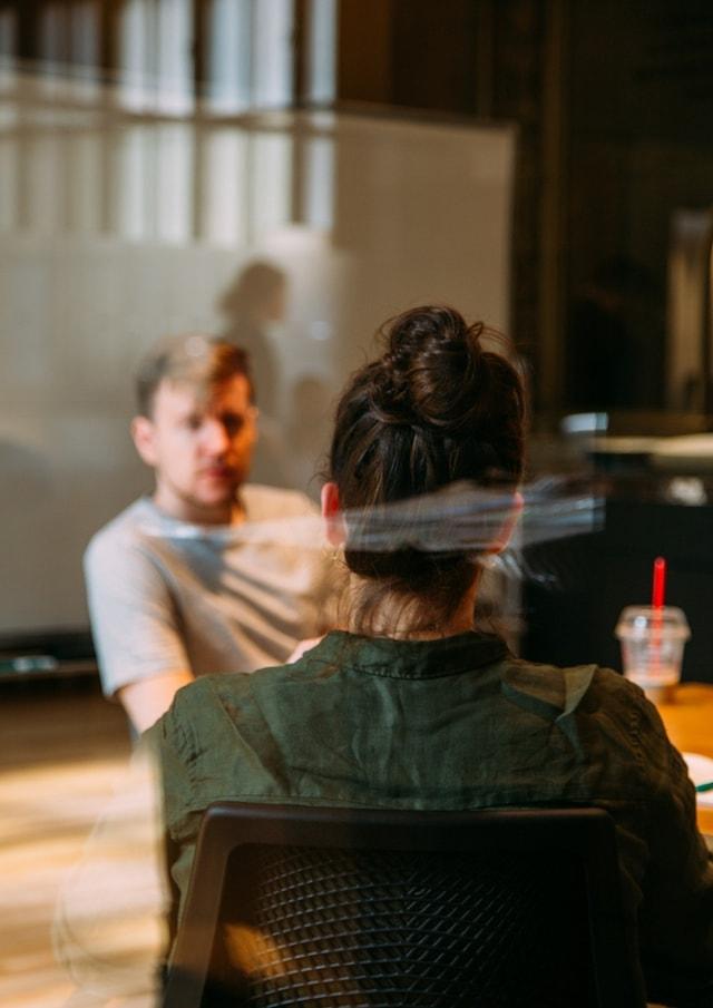 Coworking Two People Talking]