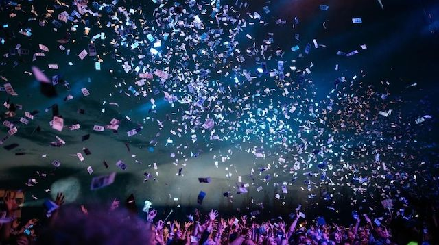 Crowd of People Throwing Paper in the Air
