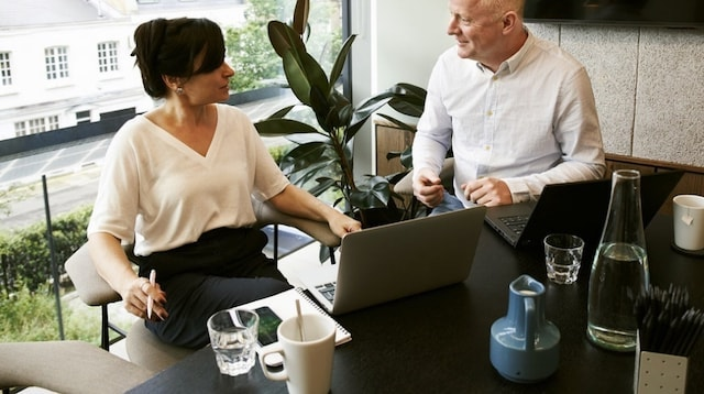 Employee Training Two People on Laptops
