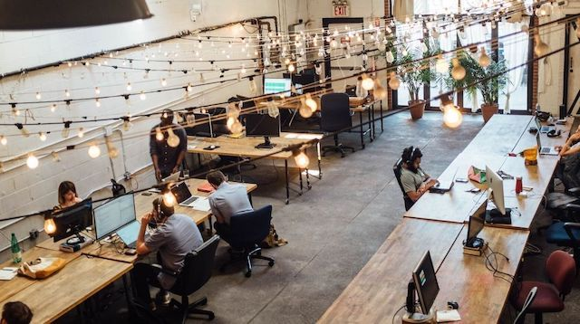 Freelance Writing People in Coworking Space