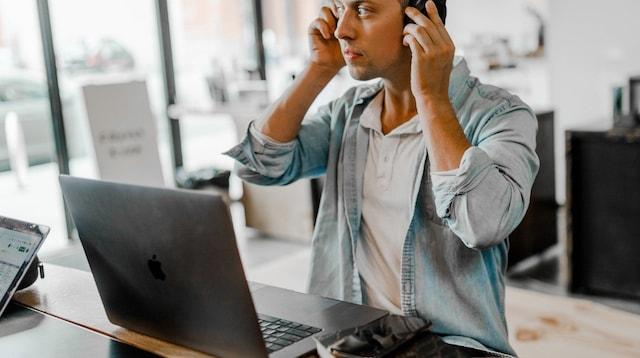 On the Job Training Methods Man Putting on Headphones