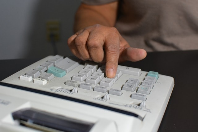 Opening a Second Business Location Man with Calculator