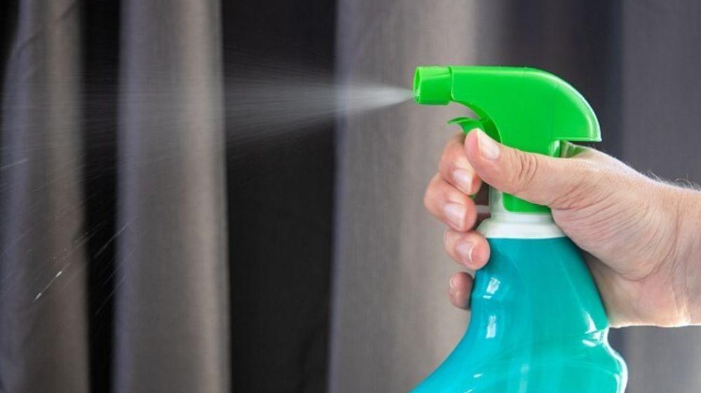 Person Spraying Sanitiser from Spray Bottle