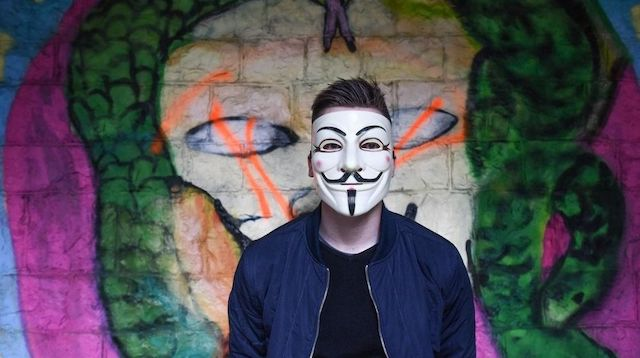 Person Wearing the Anonymous Hacker Mask