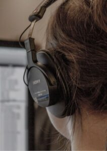 PHP Web Development Woman Coder with Headphones