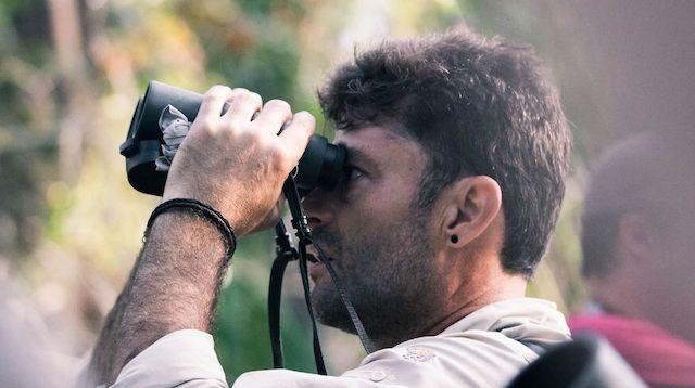 Public Liability Insurance Man with Binoculars