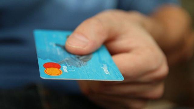 Reverse Engineering Person Holding Debit Card