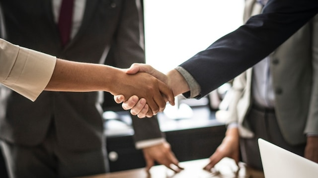 Sources of Business Finance Two People Shaking Hands