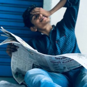 Startup Funding India Man Reading Newspaper