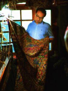 Varun Examining a Kani Shawl