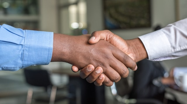 What is CRM Software Two Men Shaking Hands