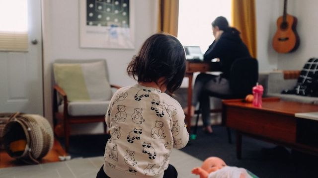 Work from Home Policy Woman Working in Room with Child