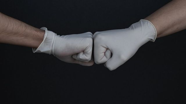Workplace Safety Two Gloved Hands Fist Bumping