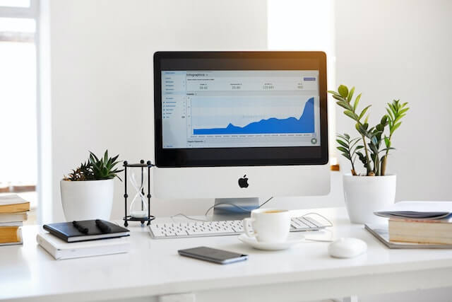 Desktop computer with analytics stats on screen