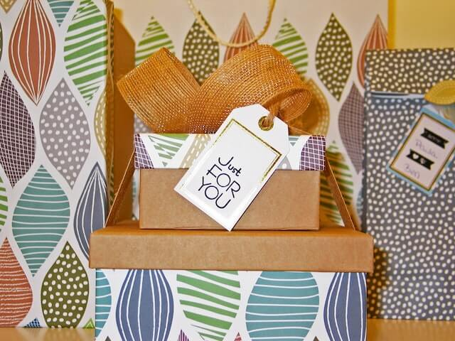 """Stacked packages with tag reading """"just for you."""""""
