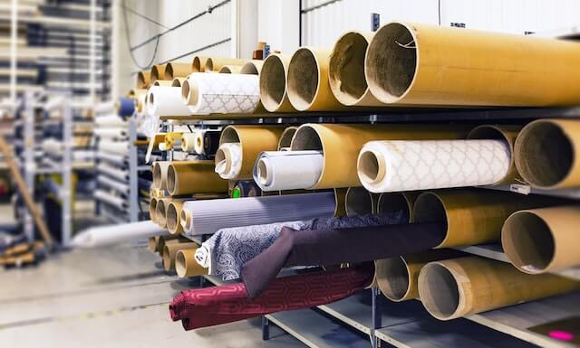 Manufacturing warehouse filled with rolls of fabric