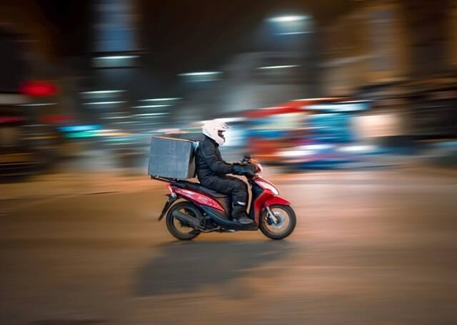 Delivery driver on a motorbike