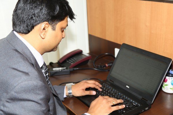 How to Open a Small Business Man in Suit at Desk