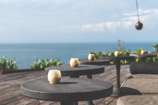Modern outdoor dining area with views of ocean in background