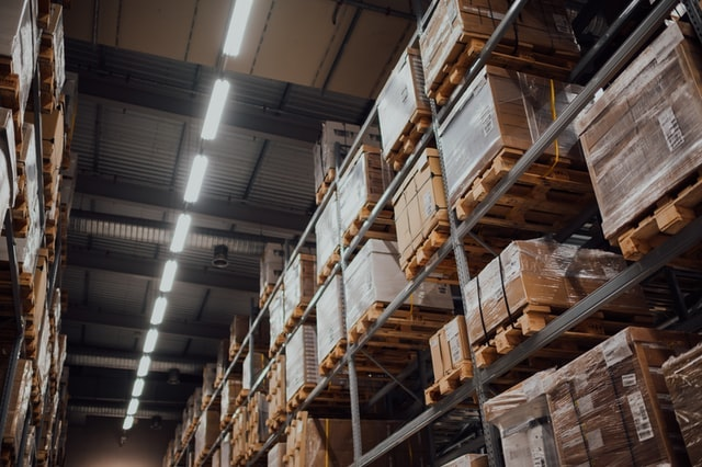 Pallets of boxes stacked on warehouse shelves
