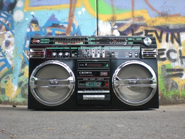 Retro boombox sitting in front of graffiti wall