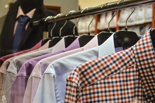 Row of men's shirts on hangers in a shop