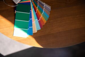 Stack of color swatches spread out on table