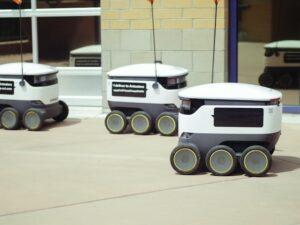 Three small robotics on wheels