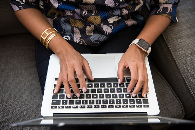Top Programming Languages Woman Working on Keyboard