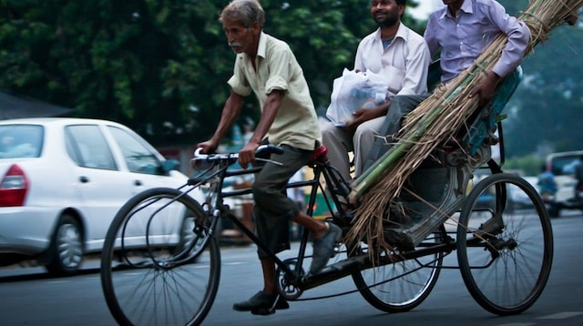 Understanding Business Taxation Men on Rickshaw