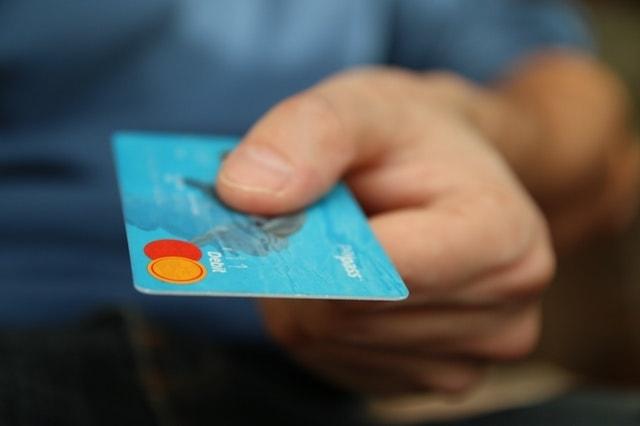 Working Capital Loan Man Holding Debit Card